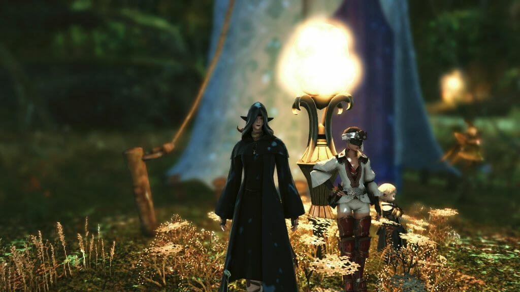Skye Grandeterre, a Duskwight Elezen, stands in Little Solace with Y'da and Papalimo in Final Fantasy XIV
