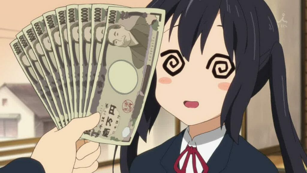 K-On! still - Azusa stands, eyes spinning, as money is waved in front of her.