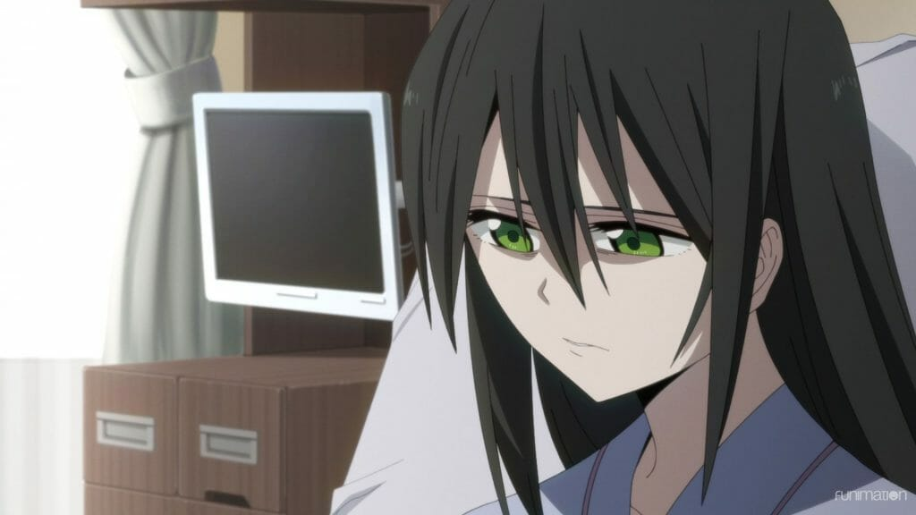 Id: Invaded Episode 10 Still - Close-up of a sad raven-haired woman with green eyes.