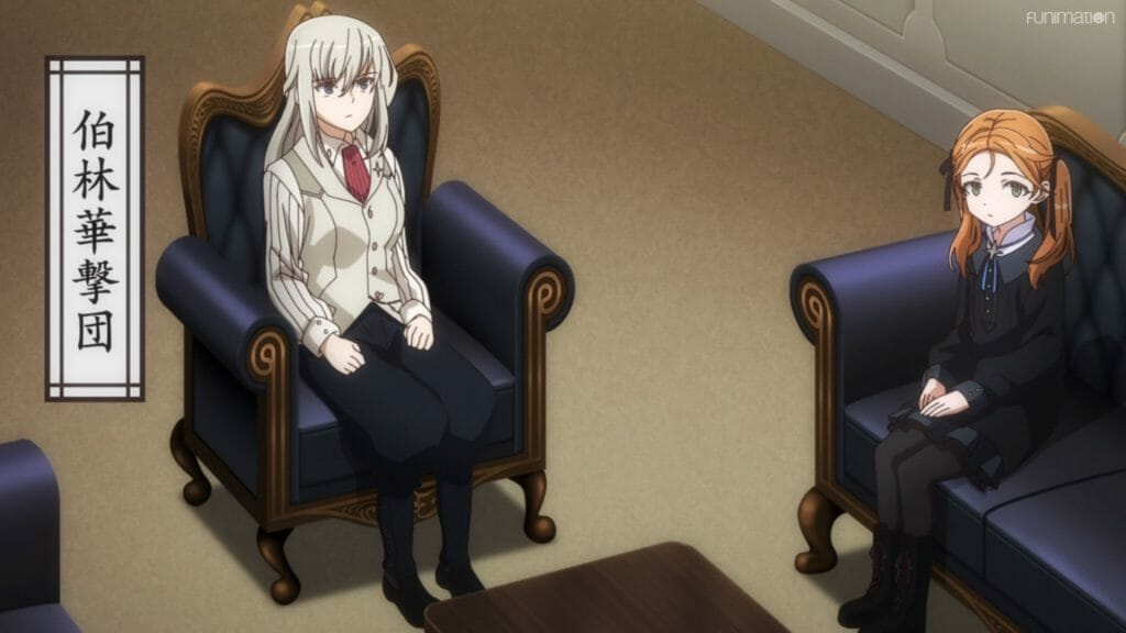 A blonde woman and a red-haired girl wearing casual clothes sit in leather chairs.