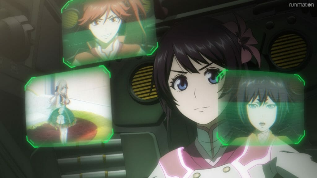 A brown-haired woman stares intently at three monitors, which feature images of people on them.