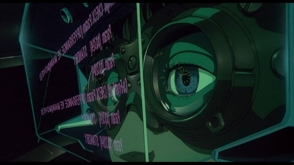 Still from Patlabor 2, which features a close-up of someone's eyes as they stare at a floating screen